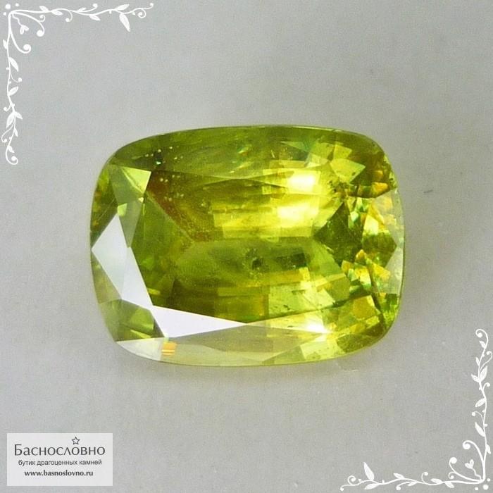 Желтовато-зелёный сфен (титанит) из Афганистана хорошей огранки кушон 9,9x7,55мм 3,1 карата (Драгоценный камень)
