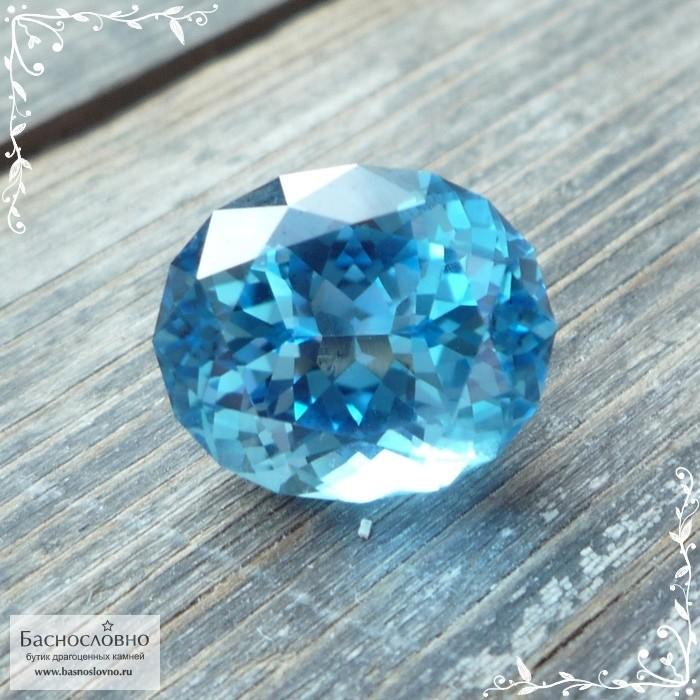 Ярко-голубой топаз (оттенок Swiss blue) из Бразилии отличной огранки в Баснословно овал 14,47x12,01мм 11,55 карат (Драгоценный камень)