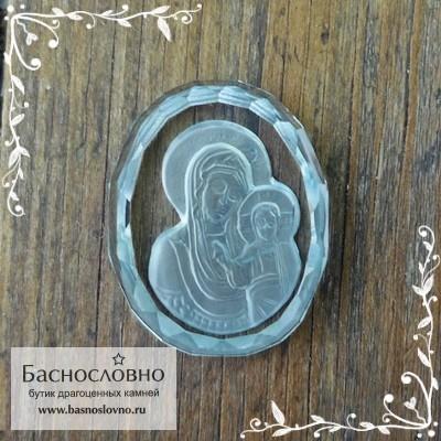 Резная Икона Казанской Божией Матери на небесно-голубом топазе (оттенок sky blue) работы огранщиков Баснословно овал 19x15мм (Драгоценный камень)