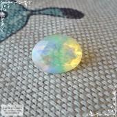 Благородный опал из Эфиопии огранки гранями овал 10,57x8,08мм 1,71 карат (Драгоценный камень)