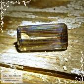 Коричневый радужный скаполит из Танзании хорошая огранка октагон 18,04x9,02мм 7,31 карат (Драгоценный камень)