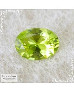 Натуральный яблочно-зелёный хризолит (перидот, оливин) из Китая отличная огранка в Баснословно овал 10,78x7,82мм 2,67 карата (Драгоценный камень)