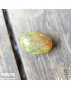Натуральный огненный опал из Эфиопии огранка овал кабошон 14×9,88мм 4,14 карат (Драгоценный камень)