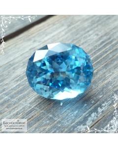 Натуральный ярко-голубой топаз (оттенок Swiss blue) из Бразилии отличной огранки в Баснословно овал 14,47x12,01мм 11,55 карат (Драгоценный камень)